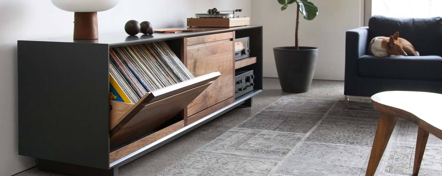AERO Modern Audio Rack with LP Swivel Bin storage cabinets holding 120 LPs. Crafted with rich dark North American hardwoods in a living room setting.