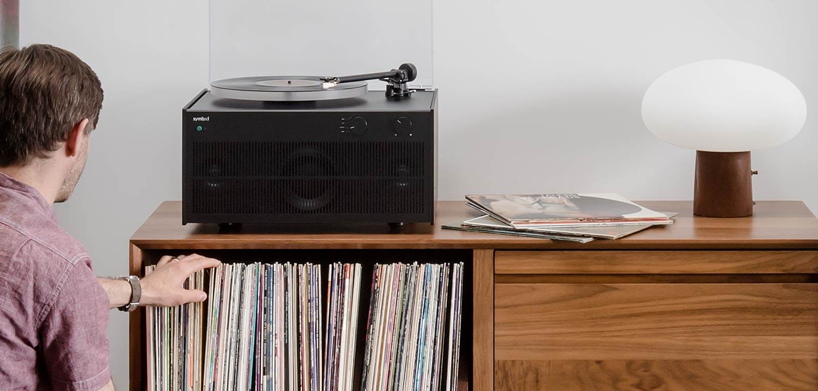 Modern Record Player Black theme sitting on Unison AERO Cabinet Program unit.